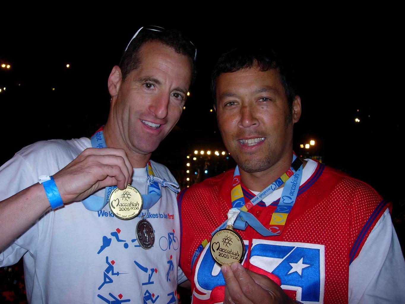 Triathlon Trial Lawyer Doug Landau Spears medals.JPG