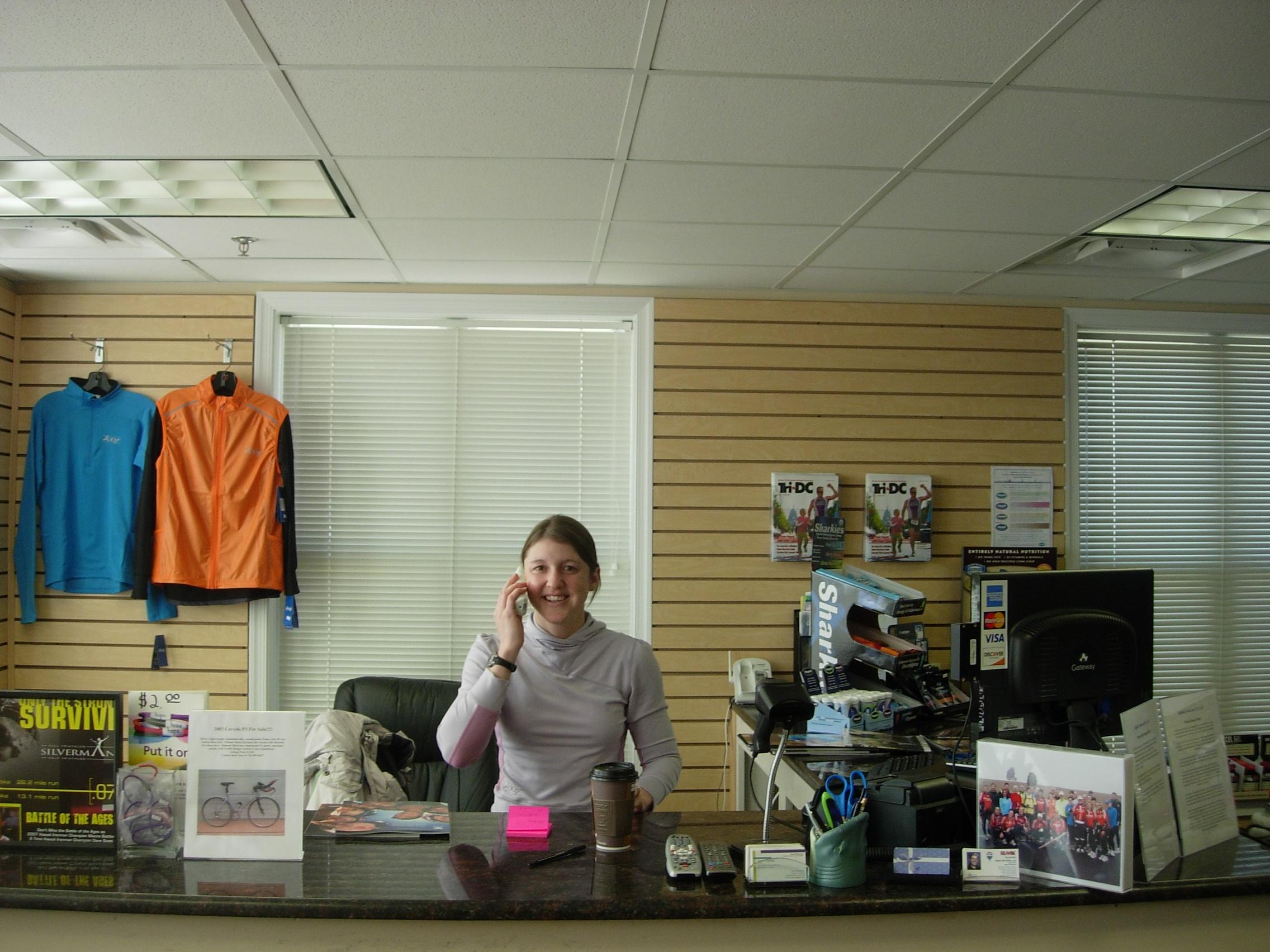 Shandra Richardson of Riptide Swim & Sport helping a customer over the phone.